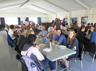 "Our first meal together at the marae. In the forefront happy high school  students from Auckland willing to learn astrobiology  ""stuff."""